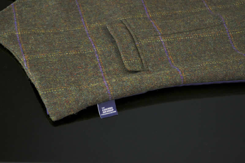close up of tax tab on The Coaching Inn uniform (waistcoat)
