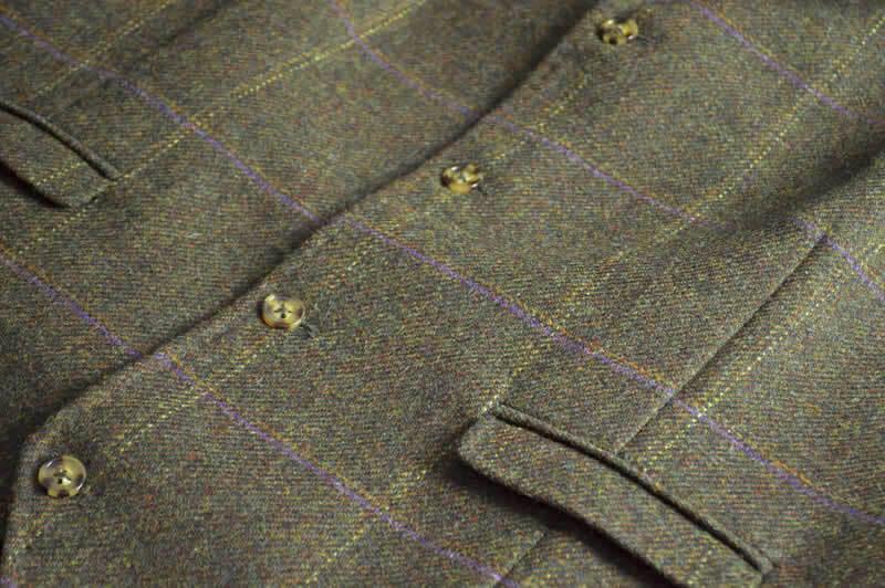 close up of fabric detail on The Coaching Inn uniform (waistcoat)