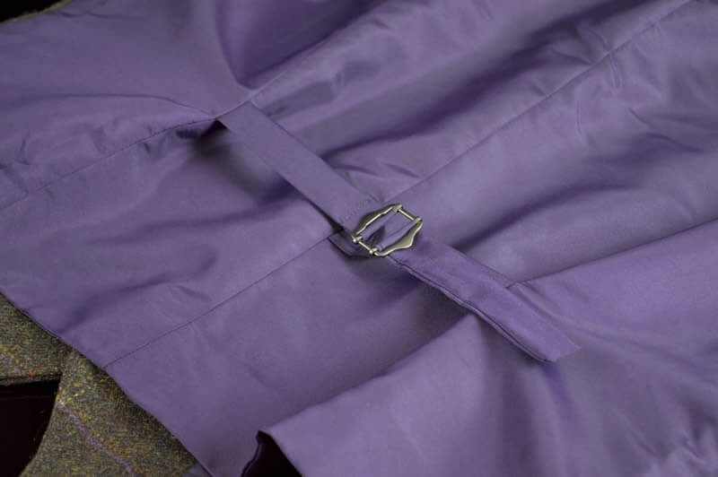 close up of the purple fabric on the back of The Coaching Inn uniform (waistcoat)