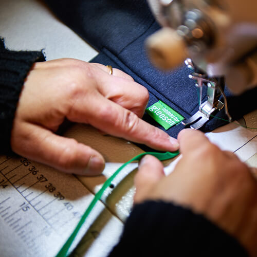 Tax tabs: tax tab being machined onto clothing