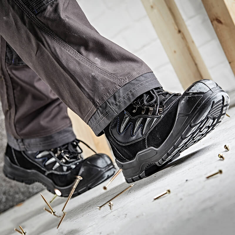 Man's feet wearing safety boots